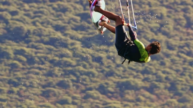 slo mo kiteboarder performing a jump - kiteboarding stock videos & royalty-free footage