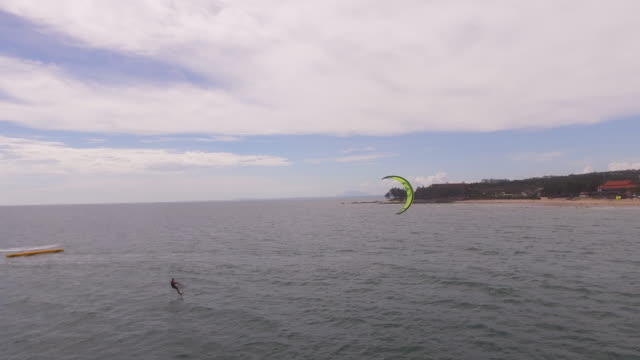 kitesurfer on a kitefoil board - kite sailing stock videos and b-roll footage
