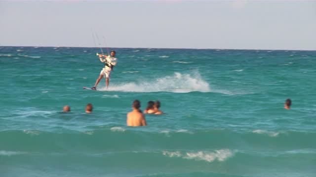 ms pan tu td  kitesurfer passing along beach and jumping / varadero, matanzas, cuba - varadero beach stock videos and b-roll footage