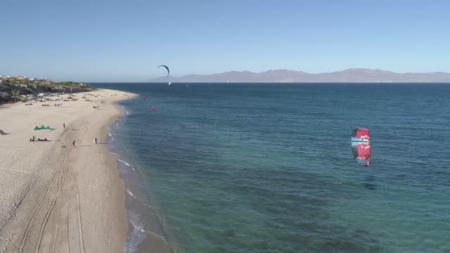 kitesurfers enjoy the windy weather sailing in the gulf of california in this aerial view during a day amid covid-19 pandemic at playa la ventana on... - northern mexico stock videos & royalty-free footage