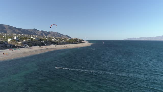 kitesurfers enjoy the windy weather sailing in the gulf of california in this aerial view amid covid-19 pandemic at playa la ventana on january 16,... - northern mexico stock videos & royalty-free footage