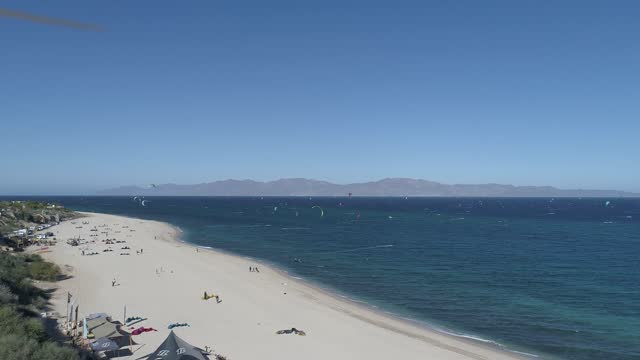 kitesurfers prepare their equipment on the beach while others navigate the waters of the gulf of california during a day amid covid-19 pandemic at... - baja california peninsula stock videos & royalty-free footage