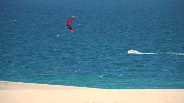 Kitesurfers surfing in the coast of spain near to africa