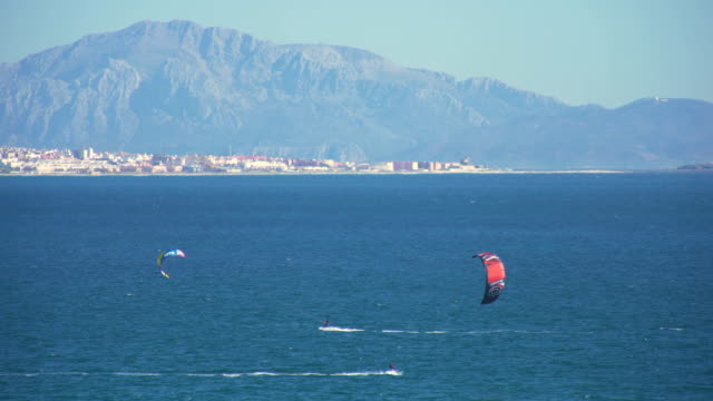 kitesurfers surfing in the coast of spain near to africa - silvestre stock videos & royalty-free footage