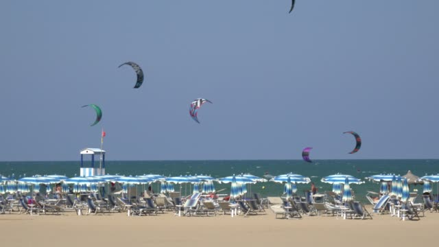 kitesurfing at sandy beach at the adriatic sea - kite sailing stock videos and b-roll footage