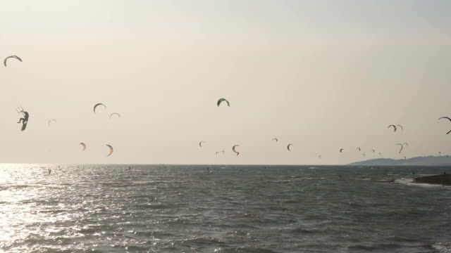 kitesurfing over horizon - kite sailing stock videos and b-roll footage