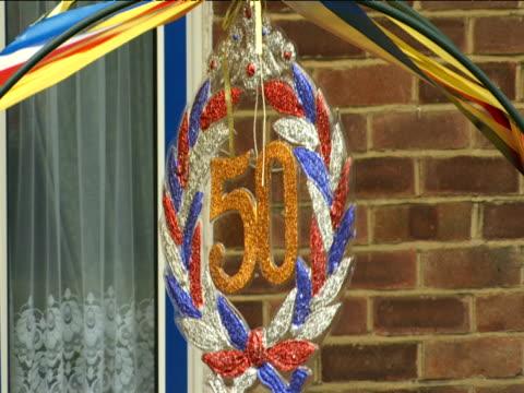 Kitsch Queen's Golden Jubilee wreath blows in the wind
