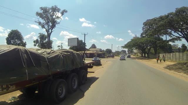 kitwe zambia driving - urban road - zambia stock videos & royalty-free footage