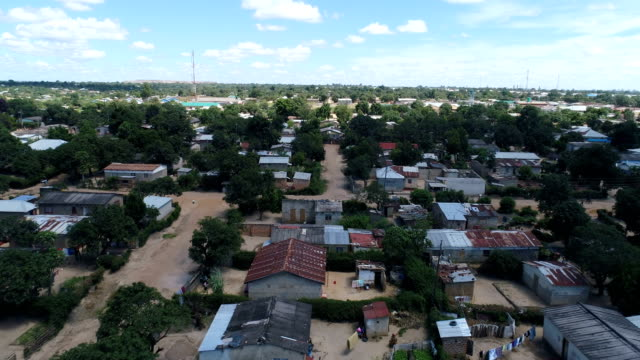 kitwe, zambia - flying over a shantytown - slum stock videos & royalty-free footage