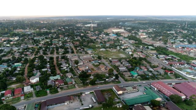 kitwe, zambia - tracking forward over a mixed neighborhood - zambia stock videos & royalty-free footage