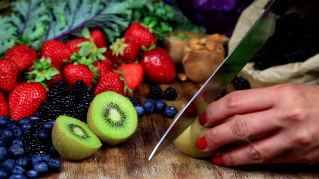 kiwi cutting - nutritionist stock videos and b-roll footage