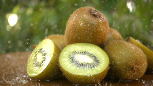 kiwi fruit being washed on green - kiwi fruit stock videos and b-roll footage
