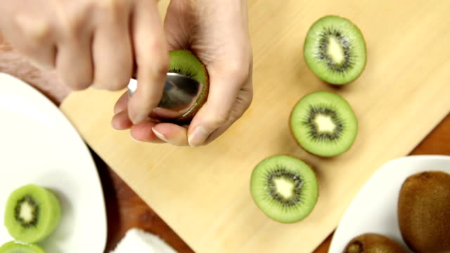 kiwi fruit cutting - spoon stock videos & royalty-free footage
