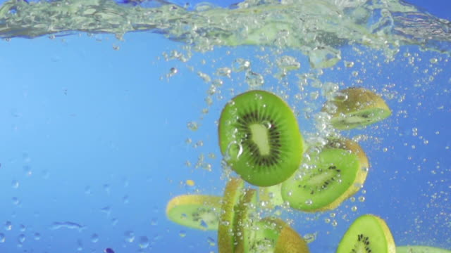 kiwi fruit splashing into water (super slow motion) - kiwi fruit stock videos and b-roll footage