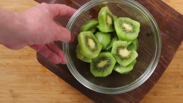 kiwi fruit. - schüssel stock-videos und b-roll-filmmaterial