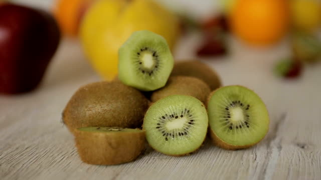 kiwi fruit,dolly shoot-close up - kiwi fruit stock videos and b-roll footage