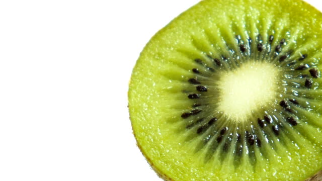 kiwi isolated on white background - kiwi fruit stock videos and b-roll footage
