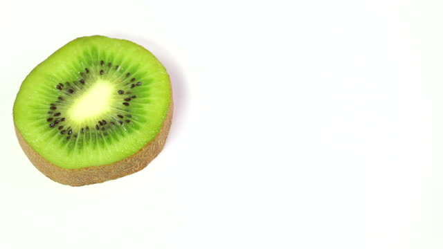 kiwi slice with text space - schneiden stock videos & royalty-free footage
