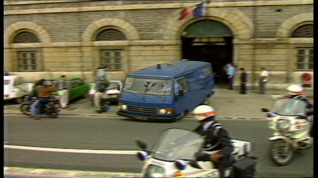 day 1; france: lyon: st joseph's prison tms small white van followed by blue prison van carrying klaus barbie out of prison gates towards, with... - crime or recreational drug or prison or legal trial stock-videos und b-roll-filmmaterial