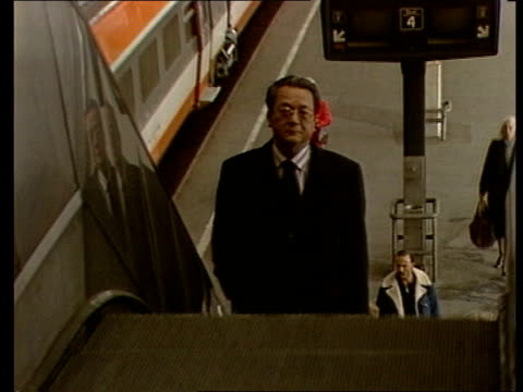 klaus barbie trial preparations; railway station: ext tms tgv train arriving at platform r-l / tms maitre jacques verges up escalator towards / bv... - crime or recreational drug or prison or legal trial stock-videos und b-roll-filmmaterial