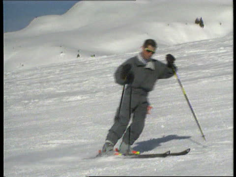 royal skiing holiday; ltms prince charles with harry and william skiing down towards