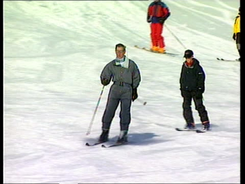 sue saville pool switzerland klosters i/c prince charles and prince harry skiing towards down mountain ms charles and harry sitting in ski chair as... - new age stock videos & royalty-free footage