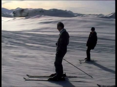 sue saville pool switzerland klosters prince charles and prince harry skiing towards down mountain ms charles and harry sitting in ski chair as along... - ski holiday stock videos & royalty-free footage