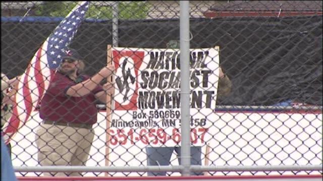 klu klux klan members held a rally in a fenced-in roller hockey rink on may 31, 2003 in berwyn, illinois. - ku klux klan stock videos & royalty-free footage