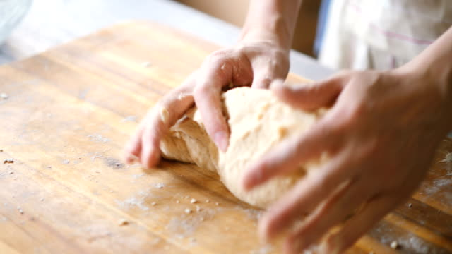 kneading bread dough for making english muffins - chopping board stock videos & royalty-free footage