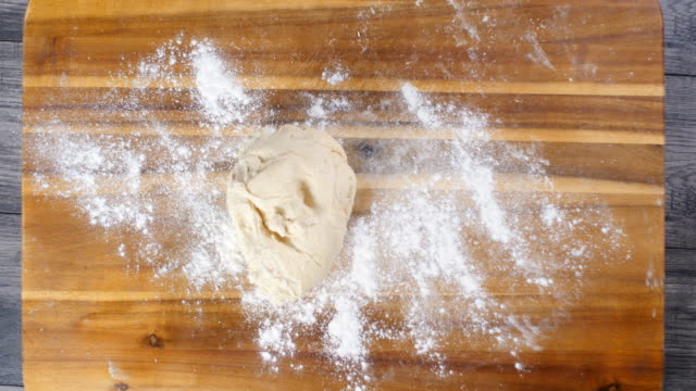 kneading bread dough for making english muffins - kneading stock videos and b-roll footage