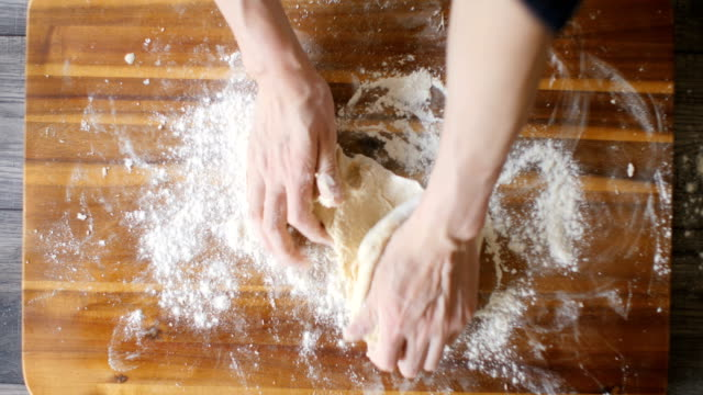 kneading bread dough for making english muffins - dough stock videos & royalty-free footage