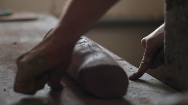 Kneading clay for pottery making