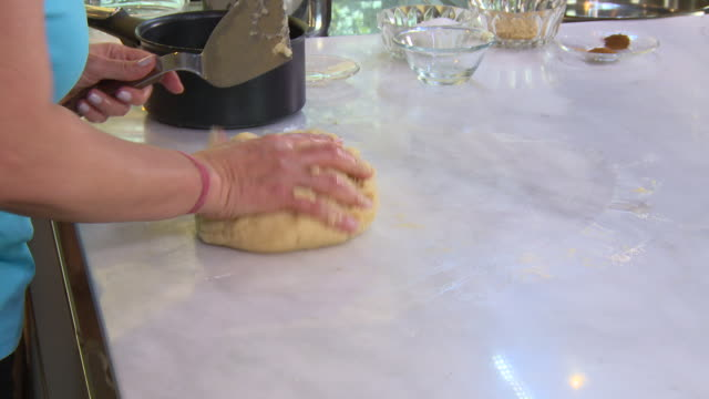 kneading dough. view of woman's hands kneading a dough ball. - eastern european culture stock videos & royalty-free footage