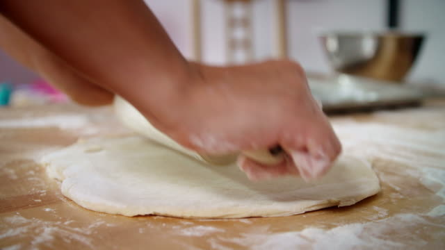 kneading dough with a rolling pin - rolling pin stock videos & royalty-free footage