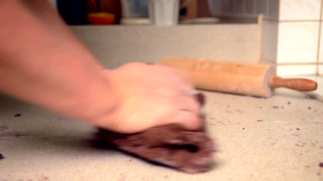 kneading the dough for chocolate cookies - mgost stock videos and b-roll footage
