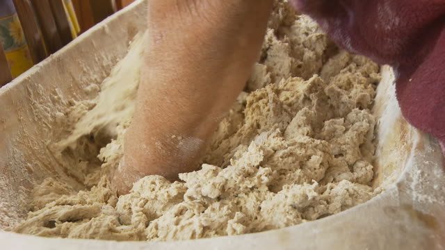 hd dolly: kneading yeast dough - peasant bread stock videos and b-roll footage