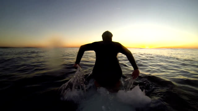 kneepaddling - surfboard stock videos and b-roll footage