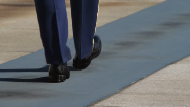 Knees-down view of guard at Tomb of the Unknowns marching away from  camera. Shot in May 2012.