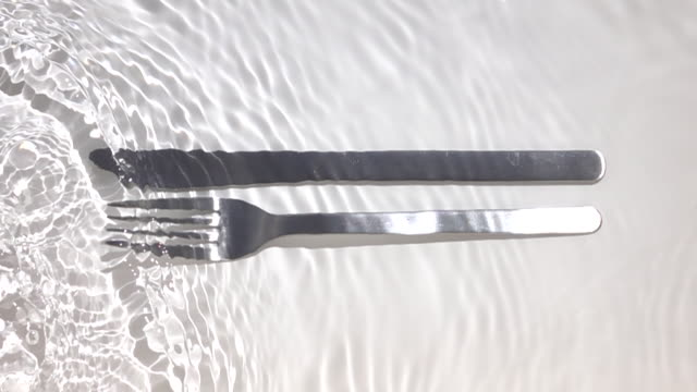 knife and fork in the water