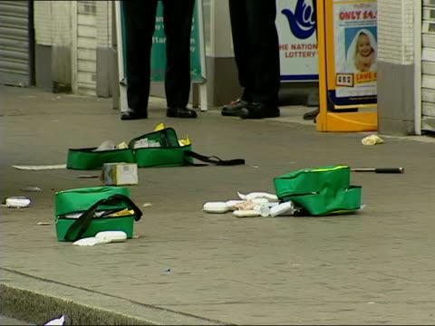 knife attack on street; lnn england: london: brixton: ext gvs police on street at scene of stabbing gv debris on street - 刺傷事件点の映像素材/bロール