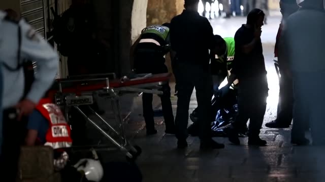 a knife attack seriously wounded an israeli border police officer on sunday at damascus gate the main entry point for palestinians to the walled old... - east jerusalem stock videos & royalty-free footage
