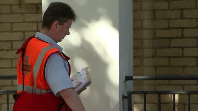 Alex Smith murder 16yearold stabbed at Regent's Park Estate Camden ENGLAND London Camden Regent's Park Munster Square EXT Post man sorting letters...