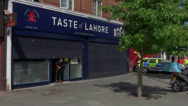 boris johnson criticises sadiq khan; england: london: harrow: ext people along past blood stains on pavement outside 'taste of lahore' restaurant... - harrow stock videos & royalty-free footage