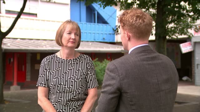 community reacts to quadruple stabbing in camberwell england london camberwell ext harriet harman mp setup shots with reporter / interview sot - itv london tonight weekend点の映像素材/bロール