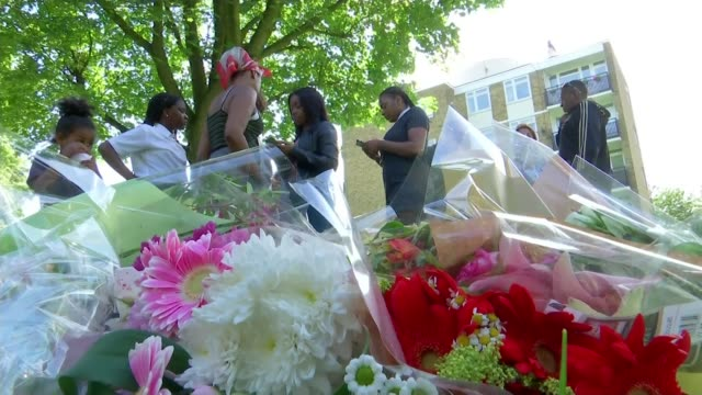 Family of murder victim Cheyon Evans pay tribute ENGLAND London EXT Maxine Grant hugging Charice Evans Floral tributes at makeshift memorial for...