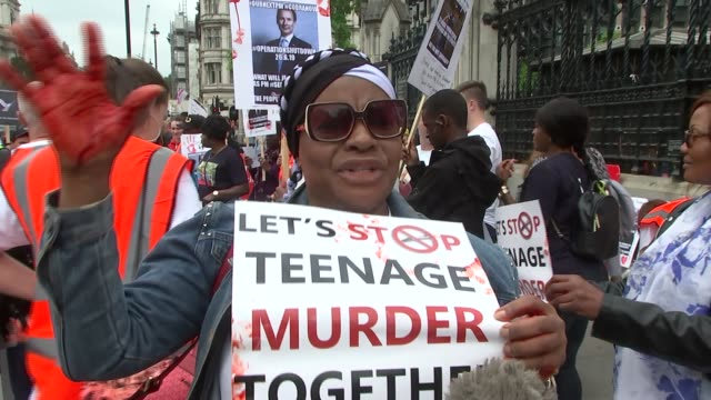Hundreds of parents marched on Parliament today demanding change ENGLAND London EXT Kay Stewart interview alongside Sarah and Chantaye SOT Stewart...