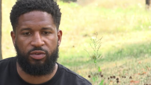 jeremy menesses murder youth worker says young men need more support england london ext sayce holmeslewis interview sot holmeslewis with reporter - crime and murder stock videos & royalty-free footage