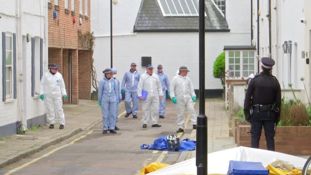 Jodie Chesney and Ayub Hassan murders ENGLAND London West Kensington Lanfrey Place EXT Various of police and forensic officers searching Lanfrey...