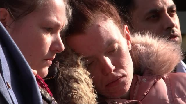 Jodie Chesney murder second person arrested ENGLAND Greater London Dagenham EXT Various of people standing for minute's silence at vigil in memory of...