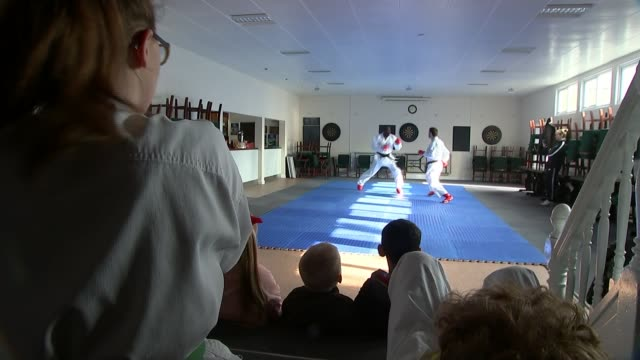 Karate champion helping to counter youth crime in London ENGLAND London INT Various of Geoff Thompson training youngsters in karate training session...